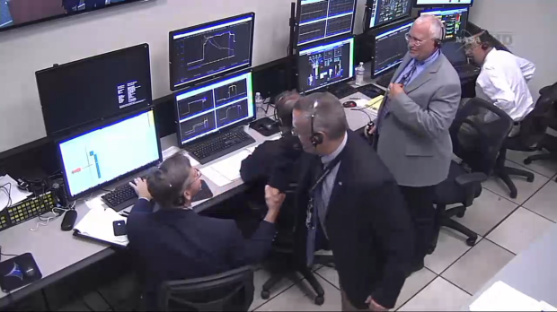 More post-launch congratulations between NASA staff members.